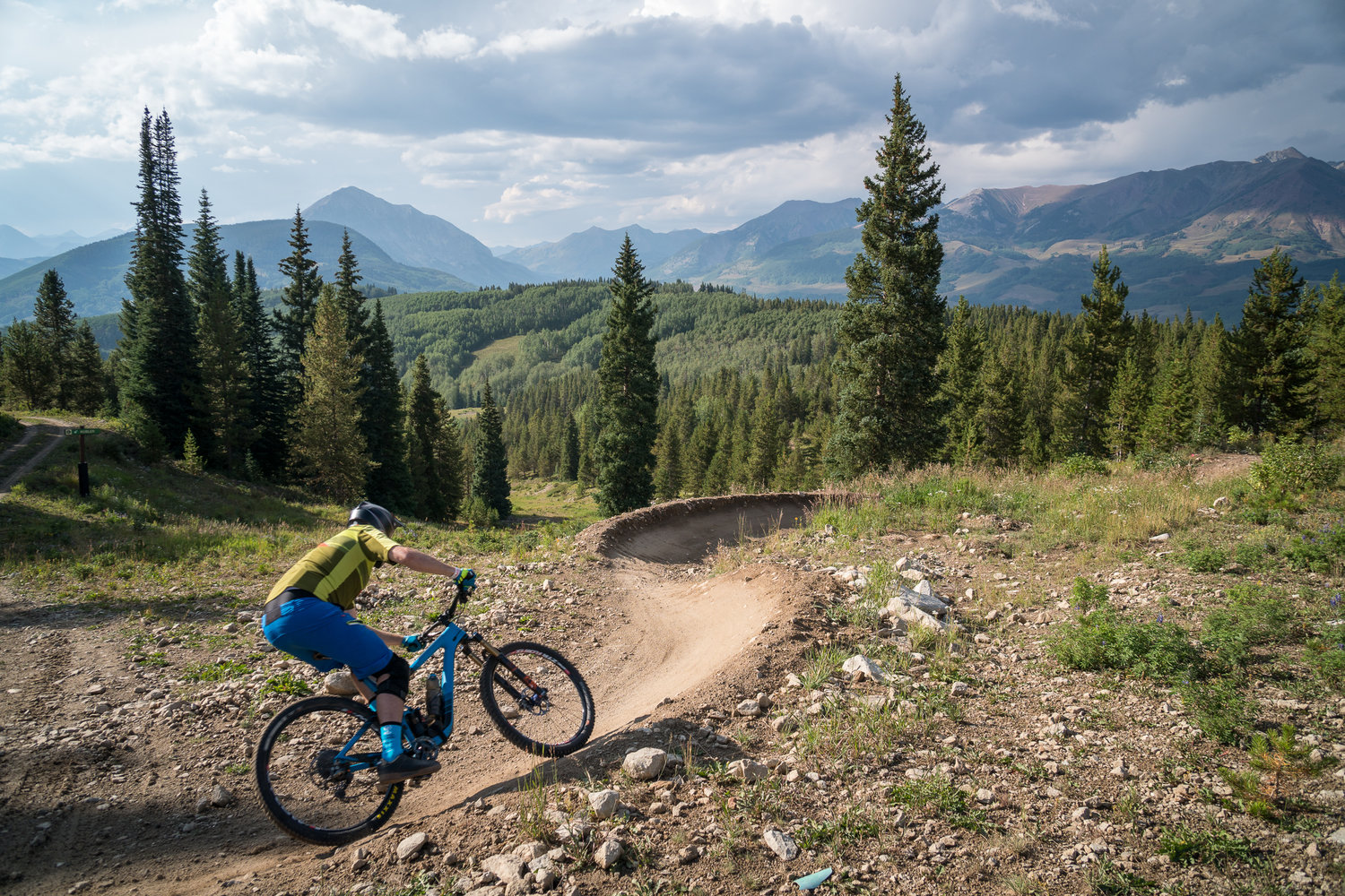 A rider demoing one of the many bikes available at Outerbike, Crested Butte, CO. Photo courtesy Outerbike.