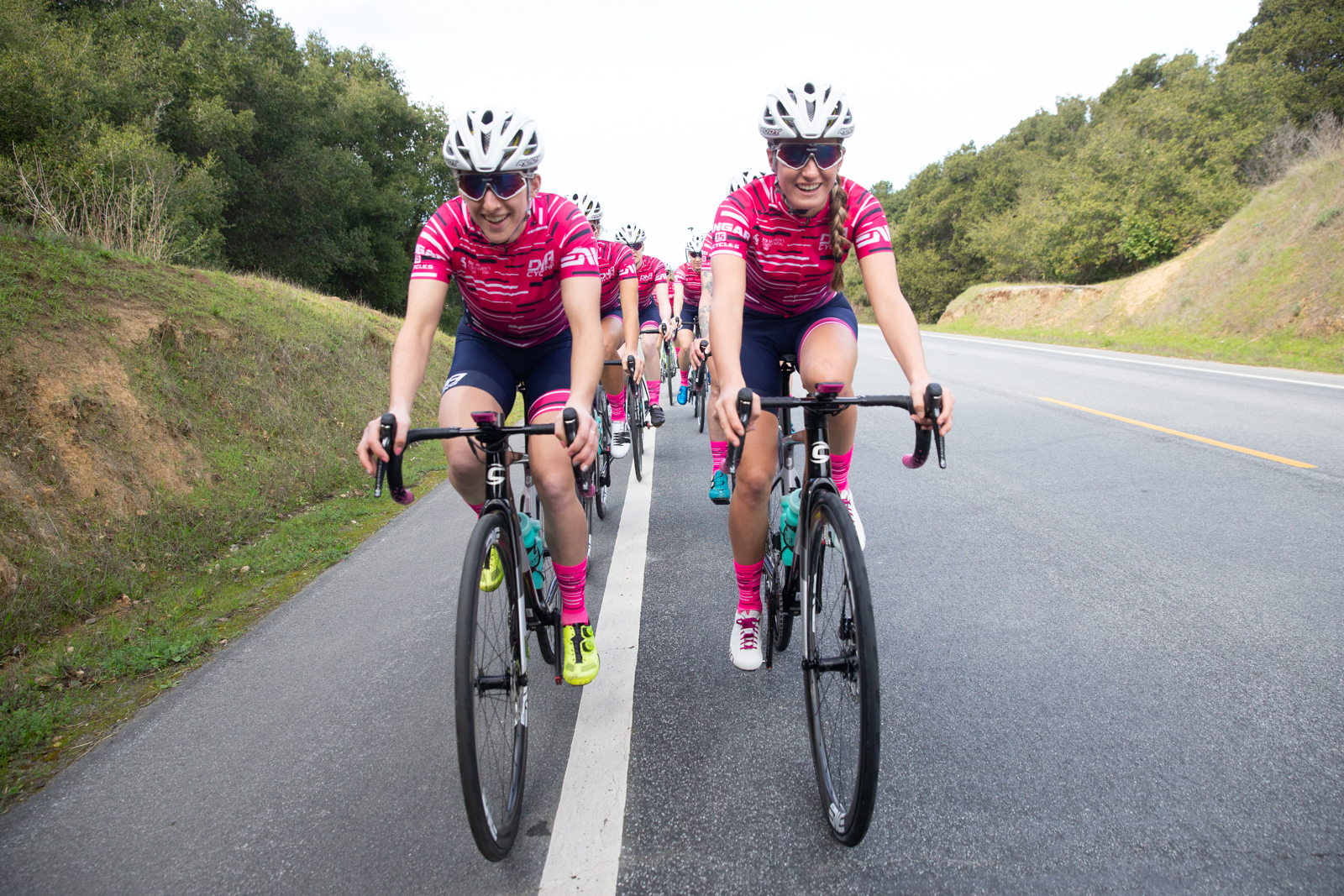 Maggie Coles-Lyster and Katie Clouse lead the team on a training ride. Photo by Catherine Fegan-Kim