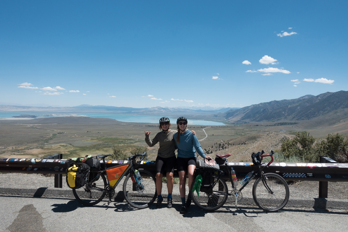 With Mono Lake and the road to Lee Vining in the background, Rain and Clara share a victory break at the top of their last big climb of the day. This was the hottest day of the trip, and also the shortest at just under 30 miles. Photo courtesy Clara Hatcher
