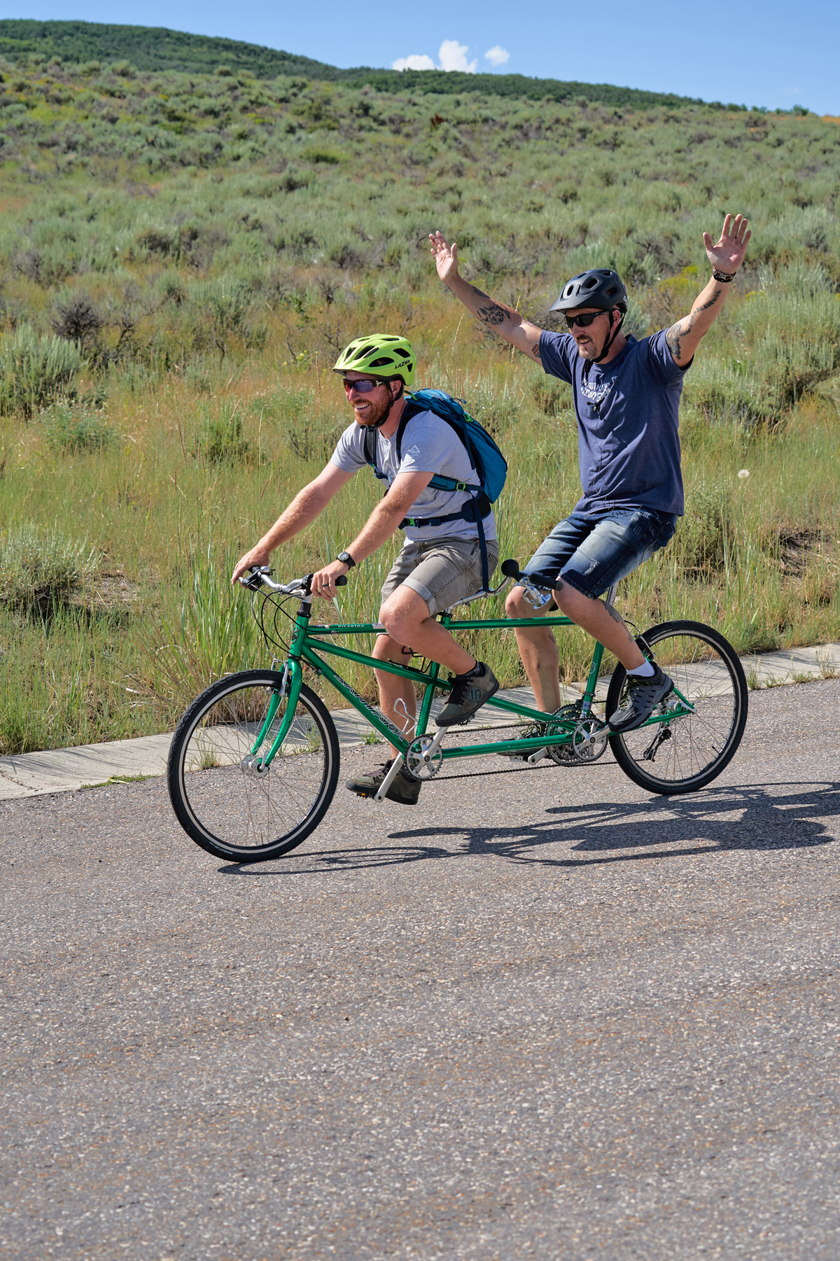 Two National Ability Center riders cycling on tandem bike during summer 2019 cycling session. Photo by Berin Klawiter