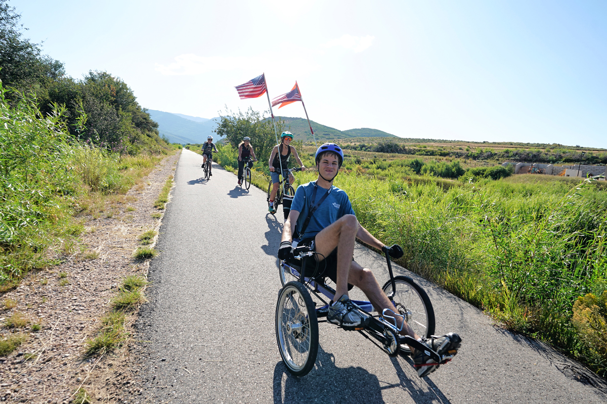 National Ability Center Team Flyers members cycling on Park City trails, summer 2019. Photo by Berin Klawiter