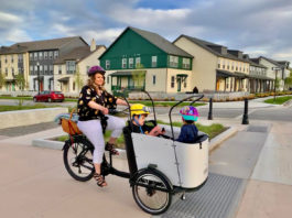 Tristin West rides through Daybreak with her kids in the cargo bike. Photo courtesy the West Family.