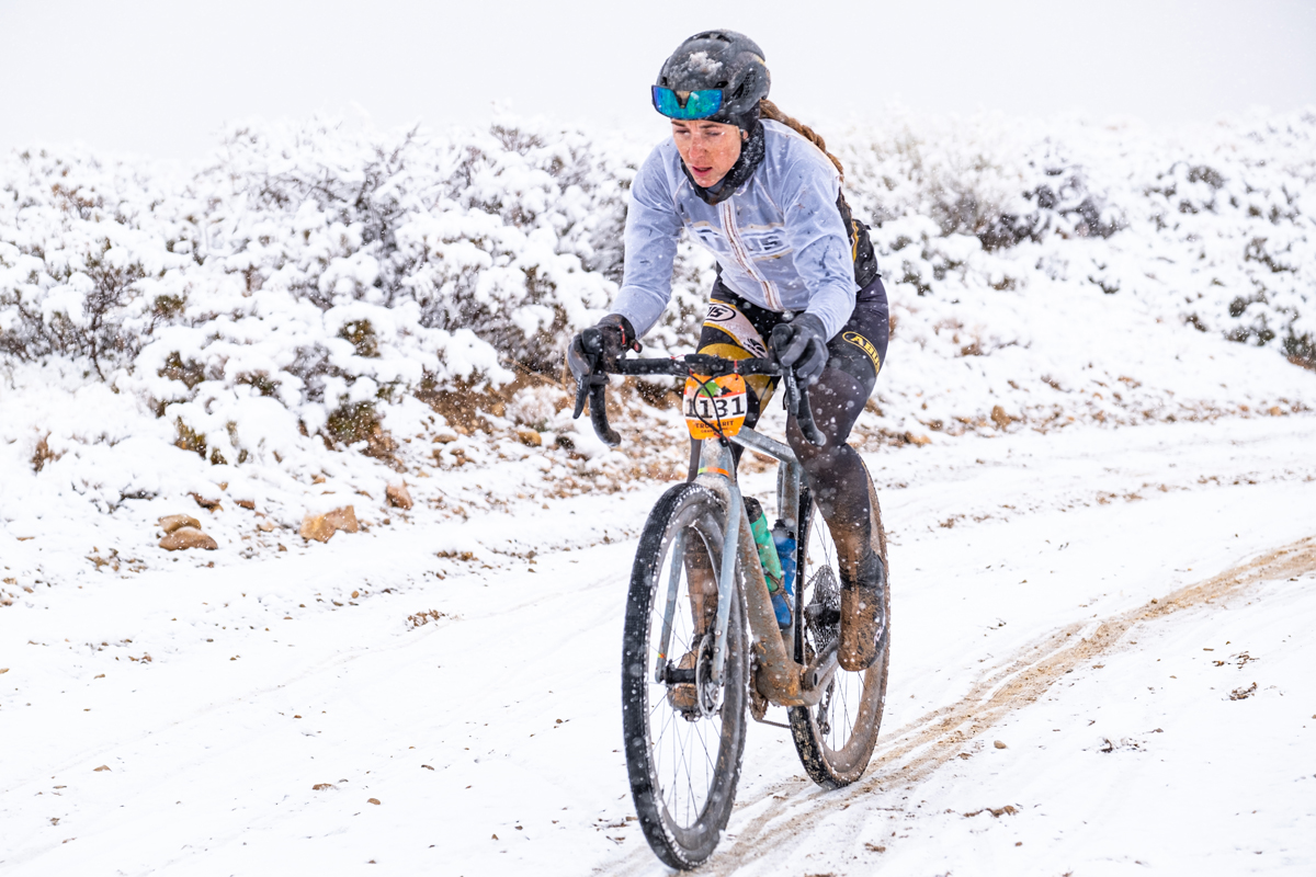 Lindsey Stevenson suffering in the snow storm during the 2021 True Grit Gravel event. Photo by Dave Amodt, True Grit Epic