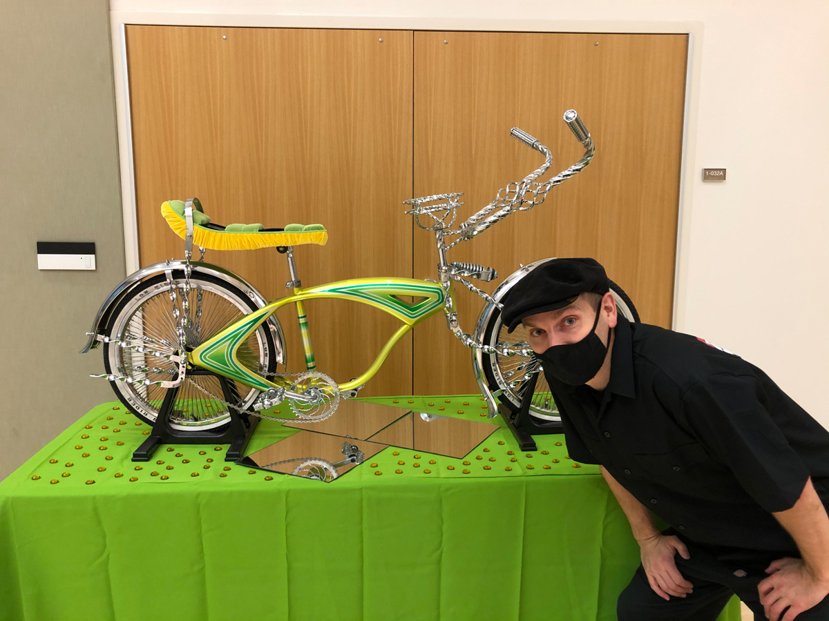 Anthony Nocella with the lowrider he builti at the 2021 Salt Lake Winter Lowrider Show. Photo by Dave Iltis