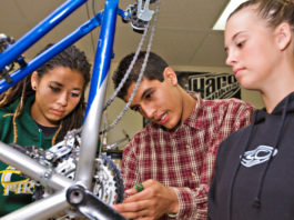 Project Bike Tech students learn hands on about the drivetrain of a bicycle. Photo courtesy Project Bike Tech