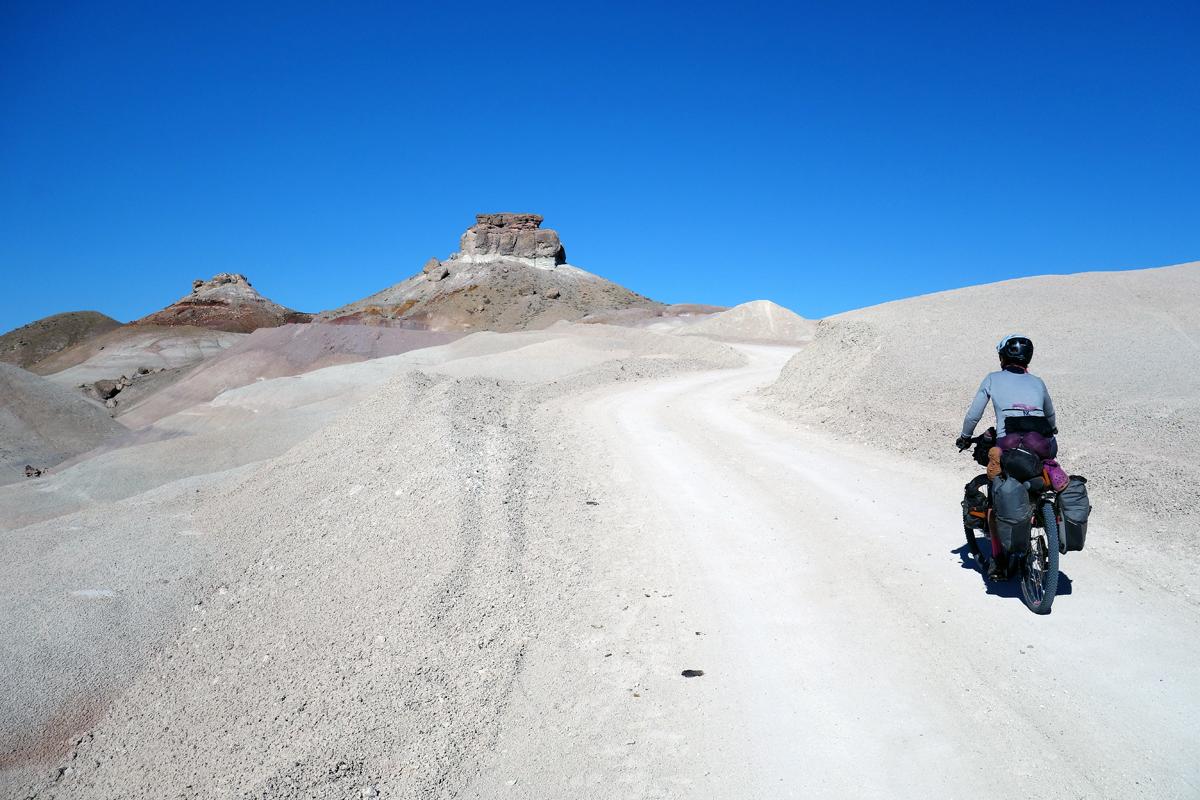 Danni Coffman rides through the Bentonite Hills. Photo by Jill Homer