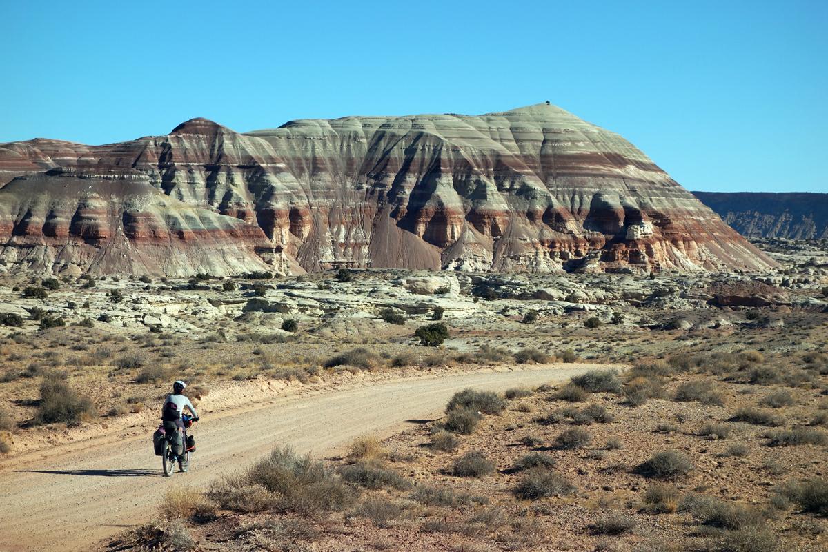 Danni rides through the Painted Desert. Photo by Jill Homer