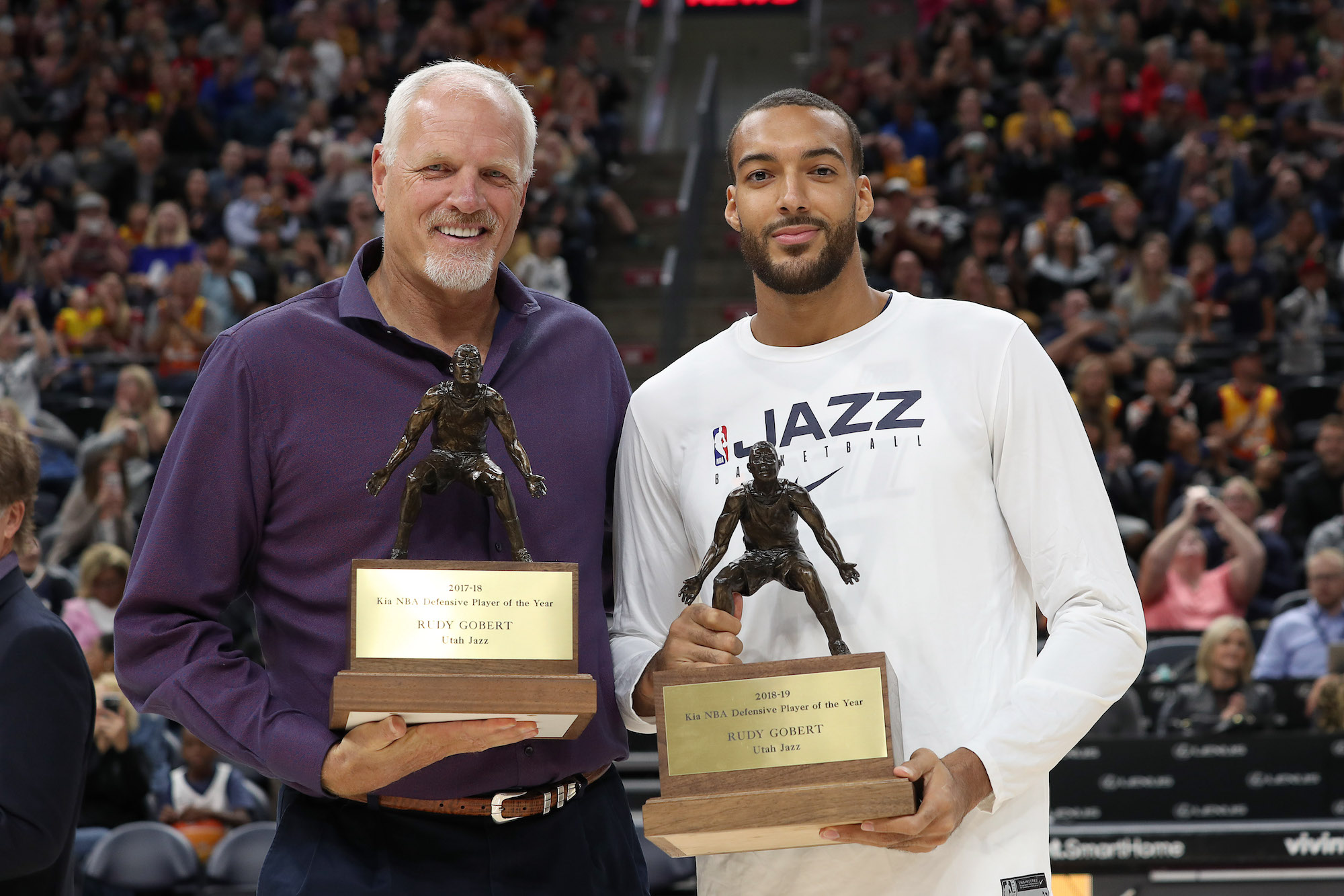 SALT LAKE CITY, UT - OCTOBER 04: Mark Eaton presents Rudy Gobert #27 of the Utah Jazz his defensive player of the year trophy during the meet the team event at vivint.SmartHome Arena on October 04, 2019 in Salt Lake City, Utah. NOTE TO USER: User expressly acknowledges and agrees that, by downloading and or using this Photograph, User is consenting to the terms and conditions of the Getty Images License Agreement. Mandatory Copyright Notice: Copyright 2019 NBAE (Photo by Melissa Majchrzak/NBAE via Getty Images)