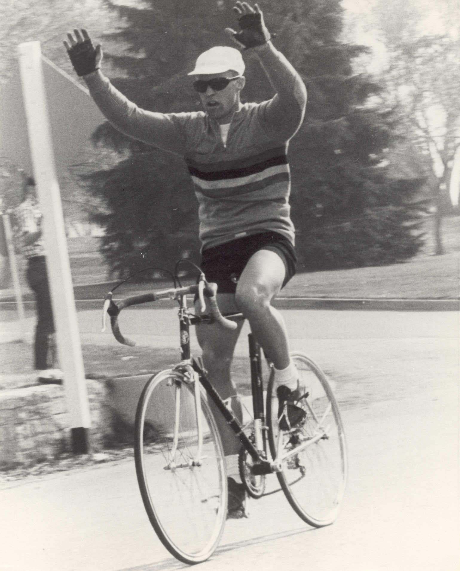Jan Hyde raises his arms in victory in the BYU to UofU campus race aboard his now-classic Cinelli racing bike.